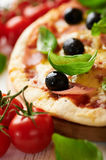 Closeup of pizza with ham and olives Royalty Free Stock Photos