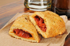 Closeup of pizza pockets and beer Royalty Free Stock Photography