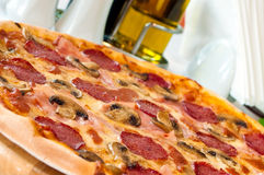 Closeup of a pizza with salami Royalty Free Stock Photos