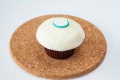 Closeup plain vanilla cream cupcake Stock Image
