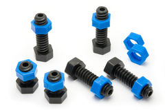 Closeup of plastic nuts and bolts Stock Images