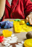 Closeup of plasticine molds and child hands on the background royalty free stock image