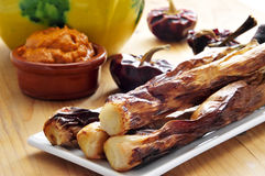 Barbecued calcots, catalan sweet onions, and romesco sauce Stock Image