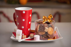 Closeup on plate with christmas cookies and cup of hot chocolate royalty free stock photography