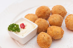 Closeup of a plate with croquetas, spanish croquettes, on a set table Stock Images