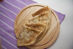 Closeup of plate with four pancakes Royalty Free Stock Photo
