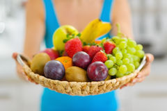 Closeup on plate of fresh fruits giving by woman Stock Photos