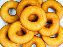 Closeup of a plate with freshly made brown doughnuts. Closeup of a plate with freshly made dark brown doughnuts Stock Photos
