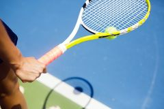 Closeup of a player holding the racquet warming up Stock Photo