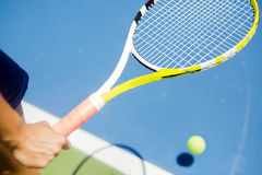 Closeup of a player holding the racquet warming up Royalty Free Stock Photos