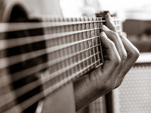 Closeup of playing an acoustic guitar Royalty Free Stock Photography