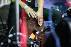 Closeup of a woman playing the Cajon. Closeup of a playing the Cajon percussion instrument Royalty Free Stock Photo