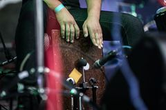 Closeup of a woman playing the Cajon. Closeup of a playing the Cajon percussion instrument Stock Image