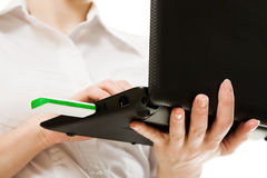 Closeup of plugging in flash drive into laptop Stock Photo