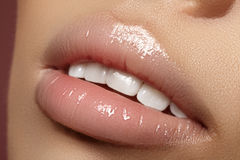 Closeup plump Lips. Lip Care, Augmentation, Fillers. Macro photo with Face detail. Natural shape with perfect contour. Close-up perfect natural lip makeup stock photos