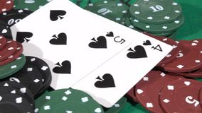 Closeup of poker chips card table surface. Poker chips and hands above it stock video footage