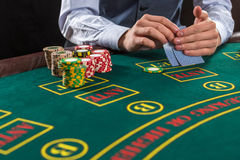 Closeup of poker player with playing cards and chips Royalty Free Stock Image