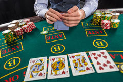 Closeup of poker player with playing cards and chips Royalty Free Stock Photos