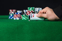 Closeup of poker player with two aces Royalty Free Stock Photography