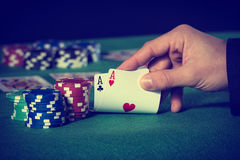 Closeup of poker player with two aces royalty free stock photo
