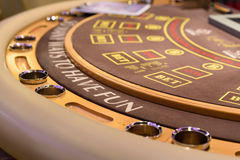 Closeup of poker table with labels bet and to have fun Royalty Free Stock Images