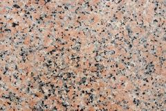 Closeup of a polished red granite texture with black and grey sp royalty free stock photo