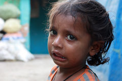 Closeup of a poor child crying from New Delhi, India Royalty Free Stock Photography