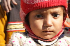 Closeup of a poor child in india. Portrait of a poor child on a street in new delhi, india Royalty Free Stock Photo