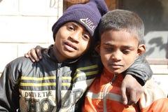 Closeup of poor children in india. Two poor children on a street in new delhi Stock Image