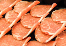 Closeup Pork raw meat slides on dish Stock Images