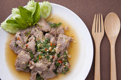 Closeup pork stir fried with basil leaves in white dish stock photos