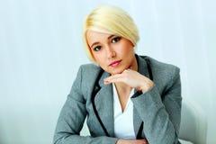 Closeup portait of a pensive beautiful businessswoman Stock Image