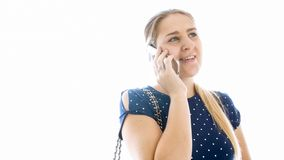Closeup portait of young smiling woman talking by mobile phone royalty free stock image