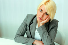 Closeup portait of a thoughtful beautiful businessswoman Stock Image
