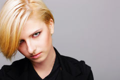 Closeup portait of a young woman with modern hairstyle Stock Photography