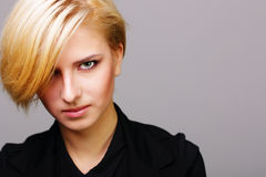 Closeup portait of a young woman with modern hairstyle Stock Images