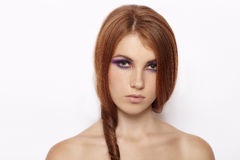 Closeup portrait of adorable cute redhead woman with violet smokey eyes makeup isolated. Closeup portrait of adorable cute redhead ladyn with violet smokey eyes Royalty Free Stock Photos