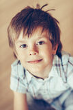 Closeup portrait of adorable smiling little boy with brown eyes Royalty Free Stock Photo