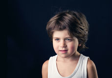 Closeup portrait of an adorable young kid smiling Stock Photo