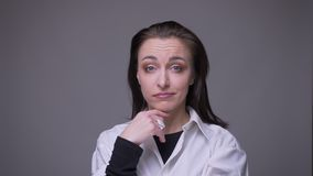 Closeup portrait of adult attractive caucasian femalenodding saying yes looking at camera with background isolated on stock video footage