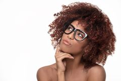 Beautiful girl with afro wearing eyeglasses. Closeup portrait of Afro American woman with curly bushy hair, wearing eyeglasses ,thinking Stock Photos