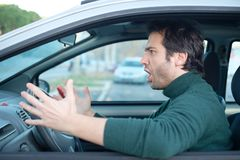 Closeup portrait of aggressive male driver honking in traffic ja Royalty Free Stock Photo