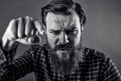 Closeup portrait of an angry bearded man threatening with his fi Stock Images