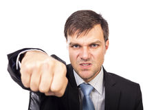 Closeup portrait of an angry businessman threatening with his fi Stock Photos