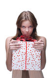 Closeup portrait of angry girl with big gift Royalty Free Stock Photography