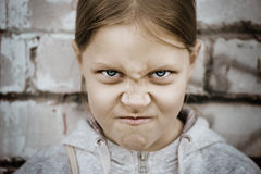 Closeup portrait of angry little girl Stock Photo