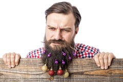 Closeup portrait of a angry man with decoration balls in his bea Royalty Free Stock Images