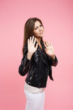 Closeup portrait angry young woman holding hands sa sign no Stock Photography