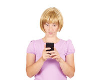Closeup portrait anxious  young woman looking at phone seeing ba Royalty Free Stock Photo