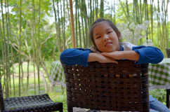 Closeup portrait of Asian girl sit on chair Stock Images